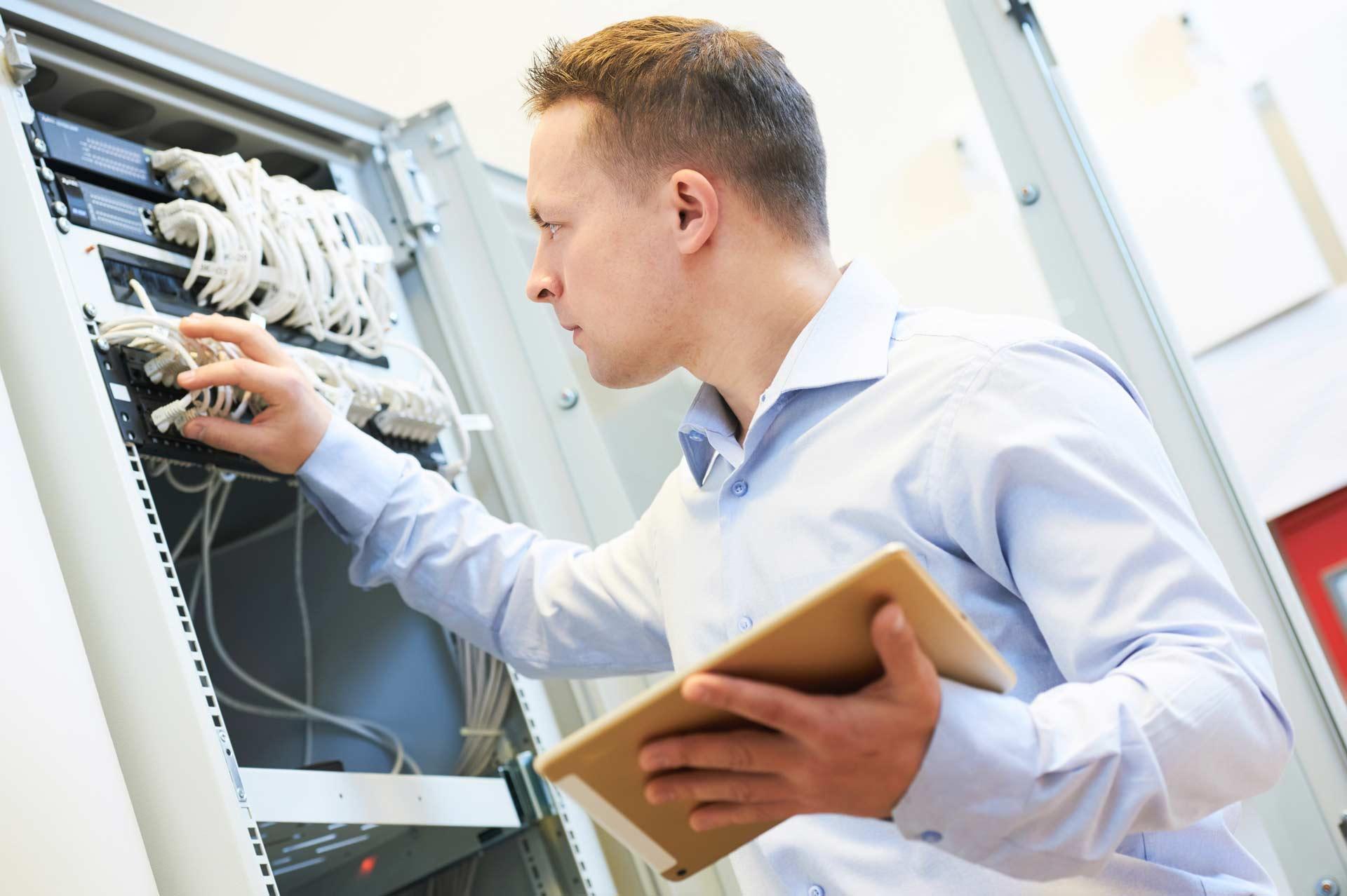 I.T. service provider inspecting a datacentre server