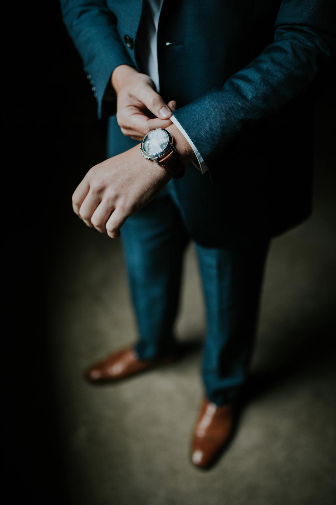 Industry providers page business man in suit adjusting sleeve with watch on wrist