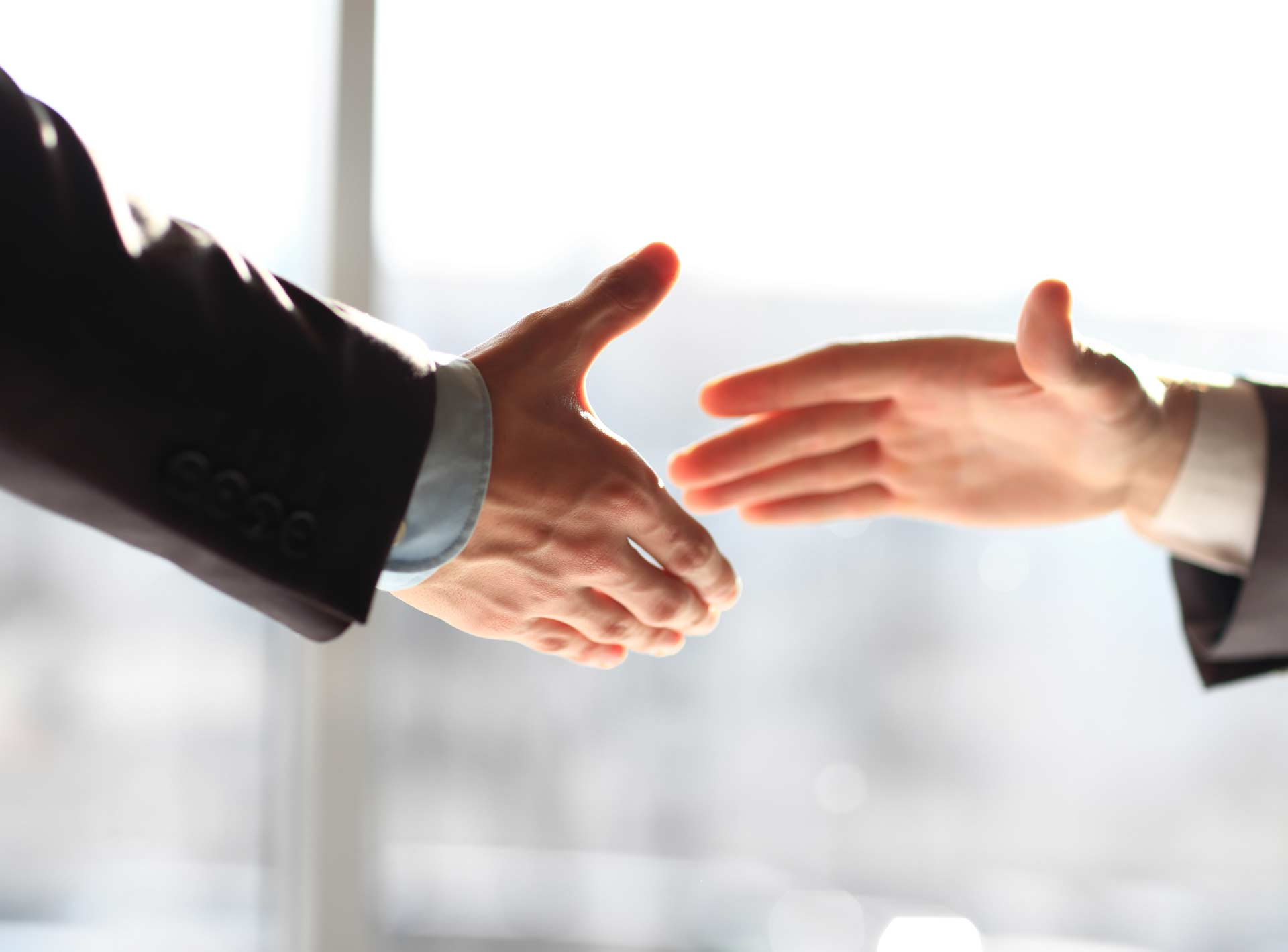 Two hands outstretched about to meet for a handshake partner trial sign up